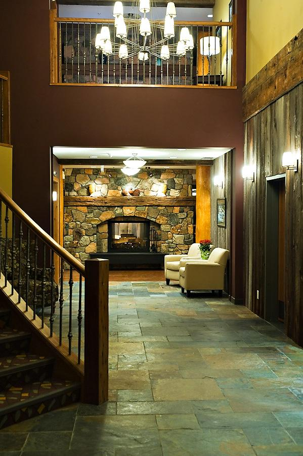 Wolf Creek Lodge foyer - showing the river rock fireplace.