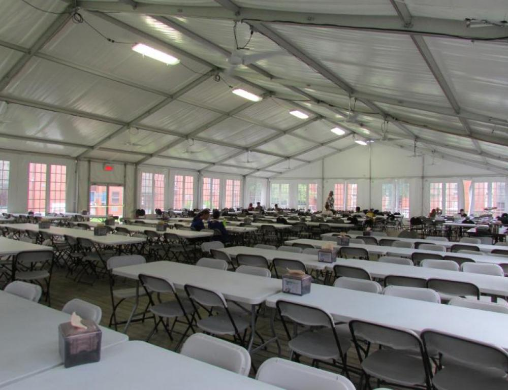250 capacity heated and cooled tent on the Dewhurst Dining Hall porch